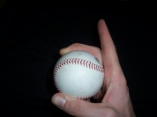 Pitching grip curveball with index finger up image